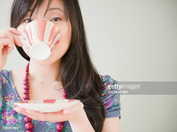 Elegant Korean woman drinking coffee