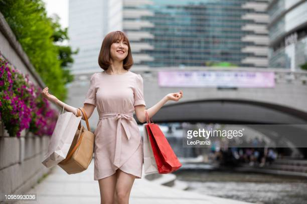 elegant korean woman in the city of seoul downtown - seoul stock pictures, royalty-free photos & images