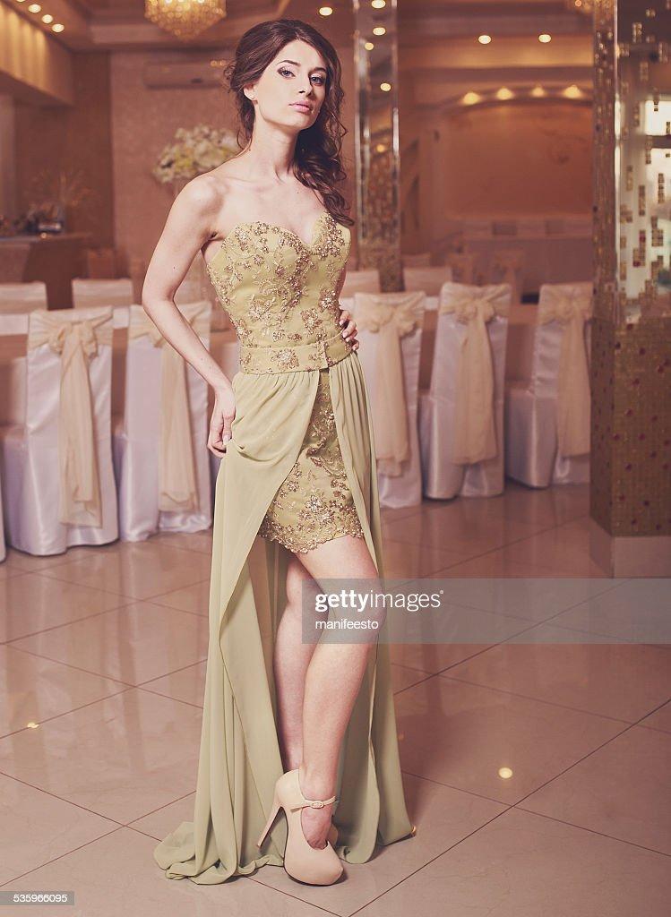 Elegant lady wearing beautiful dress in restaurant. : Stock Photo