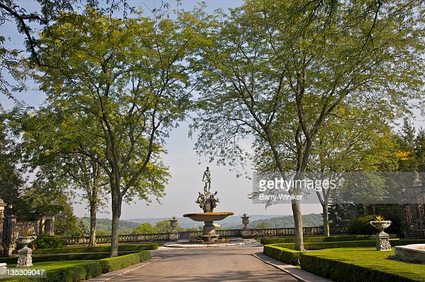 Elegant landscaping leading to fountain and view.