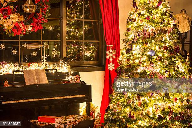 Elegant Lighted Christmas Tree By the Piano