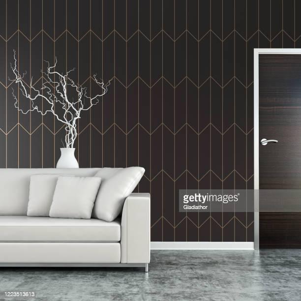 elegante soggiorno con divano, decorazione e porta su pavimento in cemento - dentro foto e immagini stock