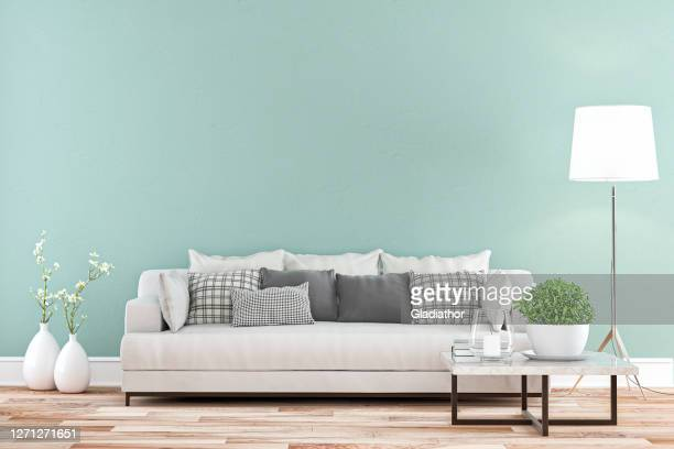 elegant living room with sofa whole view - colored wall background - mint green stock pictures, royalty-free photos & images