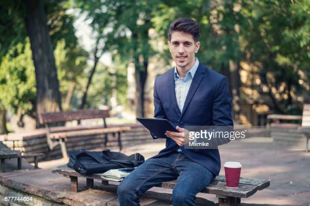Elegant man browsing on his tablet