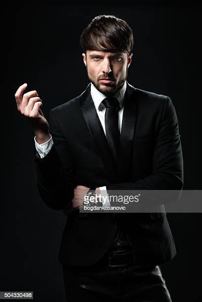 elegant man dressed in black - white tuxedo stock pictures, royalty-free photos & images