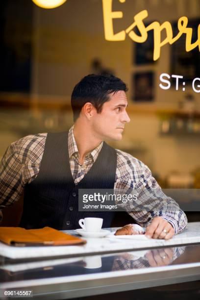 Elegant man in cafe