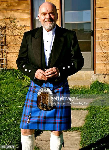 elegant man in kilt, with champagne - tartan stock pictures, royalty-free photos & images