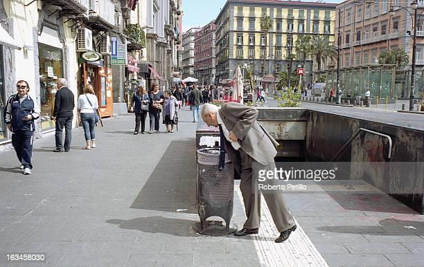 Elegant Man Looking Into a Rubbish Bin, in Napoli, Italy