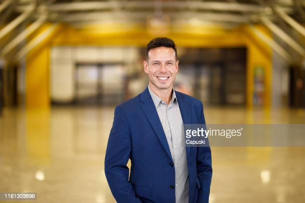 elegant man portrait at the airport - blue blazer stock pictures, royalty-free photos & images