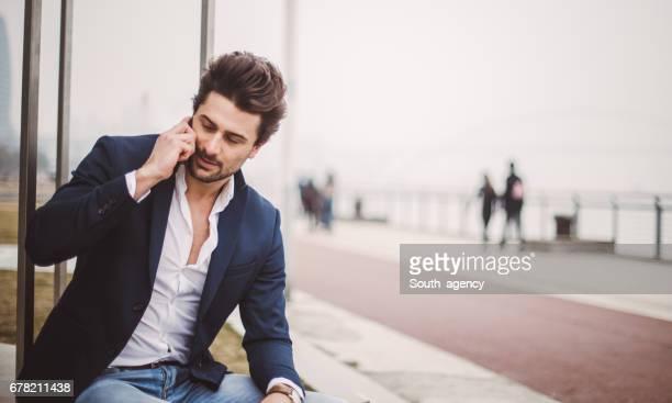 Elegant man relaxing outdoors alone