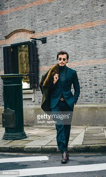 Elegant man taking a walk