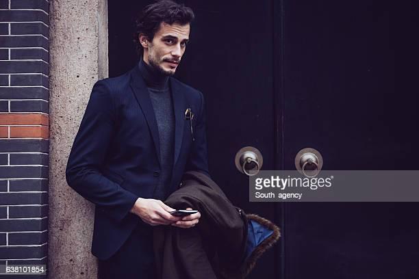 Elegant man using smart phone