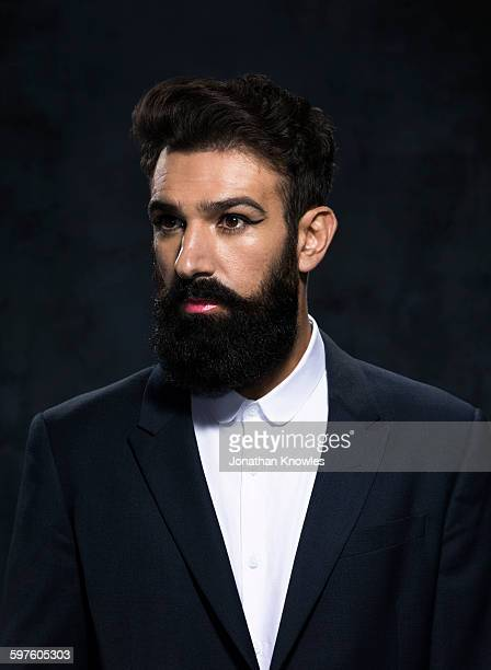 Elegant man with beard in make-up,
