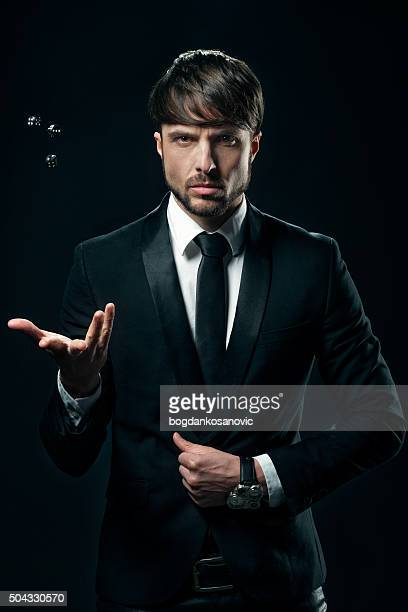 elegant man with dices - white tuxedo stock pictures, royalty-free photos & images
