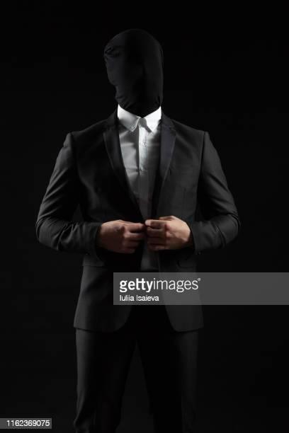 elegant man without face buttoning black suit - 陰謀 ストックフォトと画像