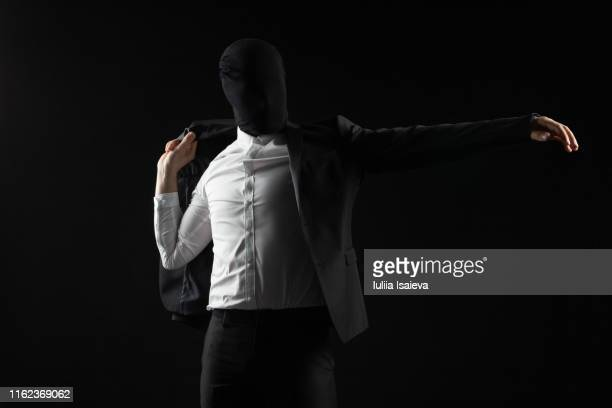 elegant man without face wearing black suit - giacca da abito foto e immagini stock