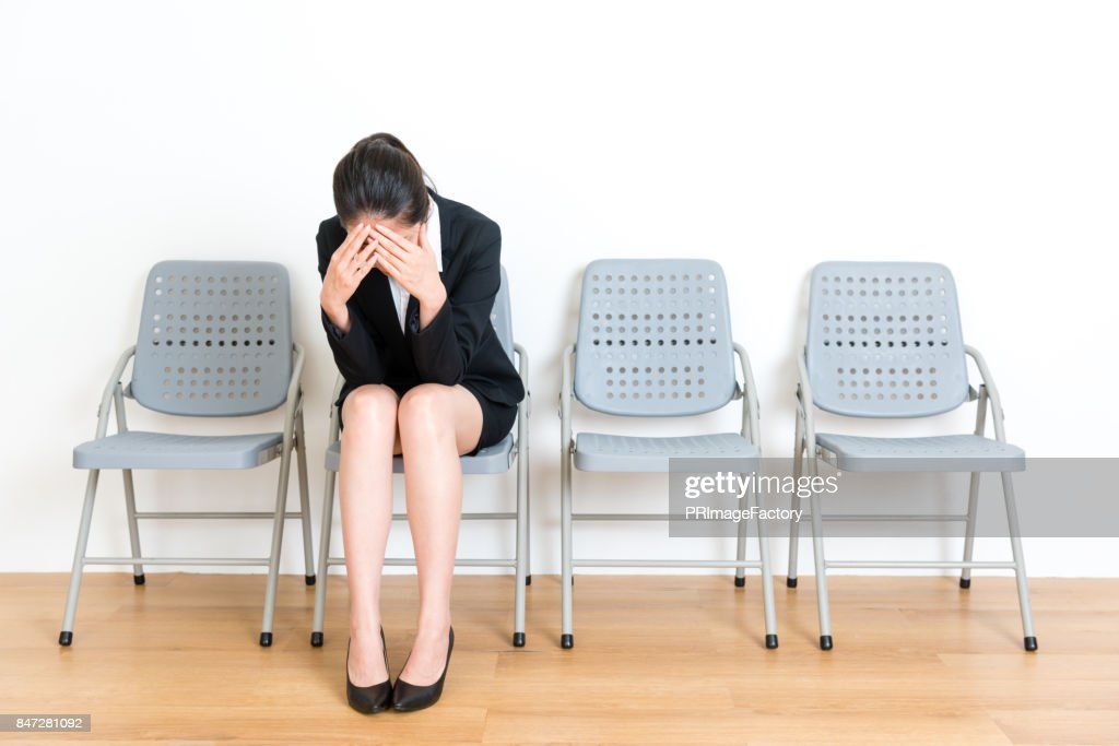 elegant manager lady sitting on wood floor chair : Stock Photo