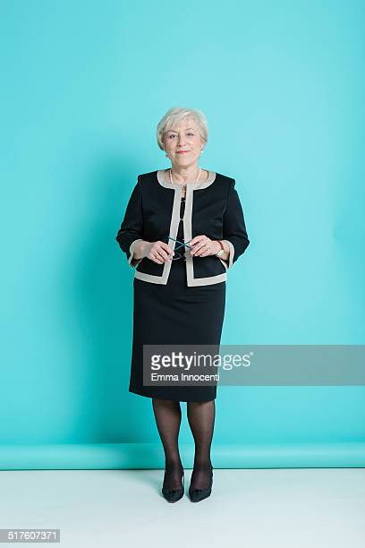 elegant mature woman standing - one senior woman only stock pictures, royalty-free photos & images