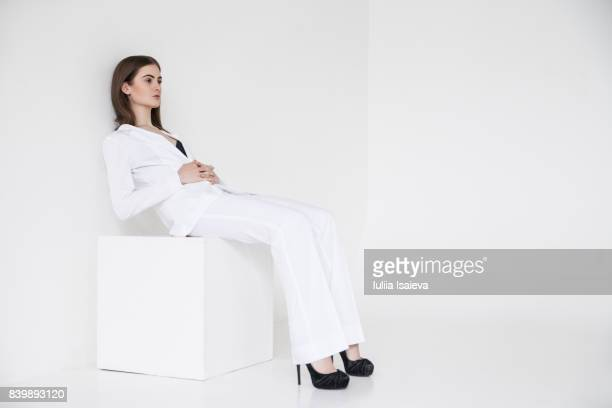elegant model in white classy suit - vogue stock pictures, royalty-free photos & images