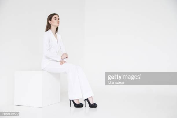 Elegant model in white classy suit
