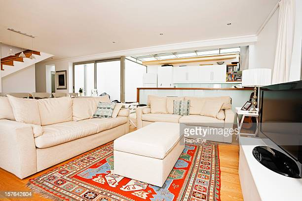 elegant modern living room in upmarket duplex development - persian rug stock photos and pictures