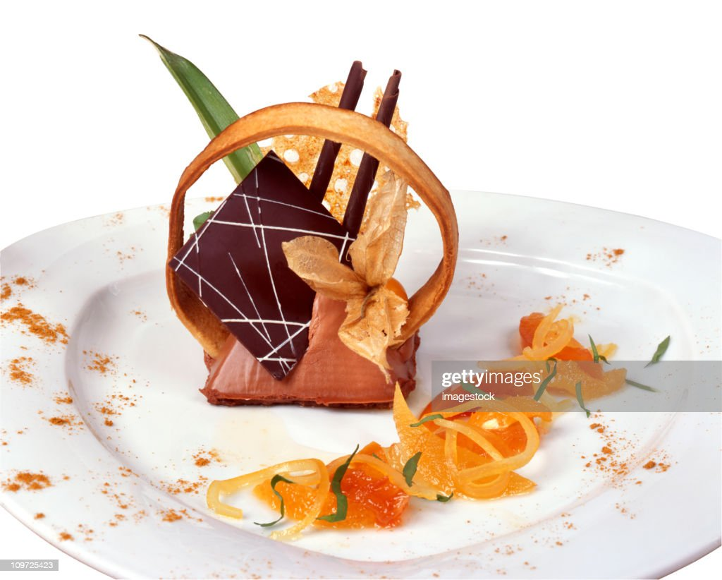 Elegant mousse with many garnishes on a white plate : Stock Photo