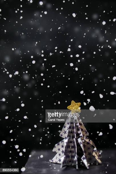 elegant origami christmas tree with snow.