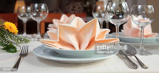 Elegant place setting with apricot colored napkin decoration
