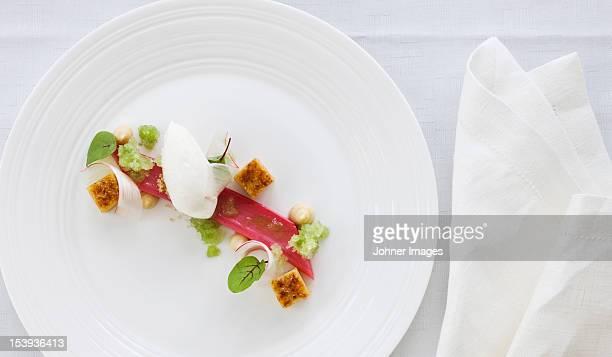 Elegant place setting with dessert