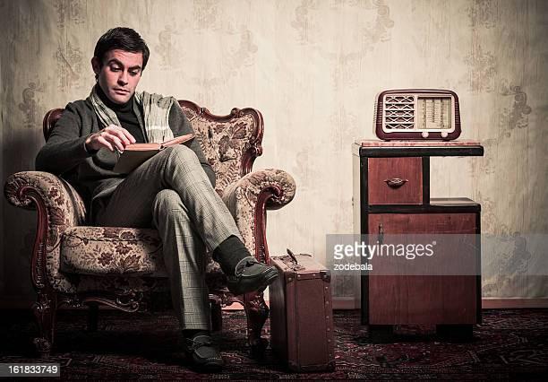 Elegant Retro Man Reading a Book in Vintage Room