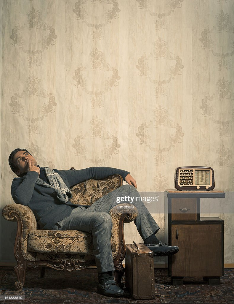 Elegant Retro Man Sitting in Vintage Room with Copy Space : Stock Photo