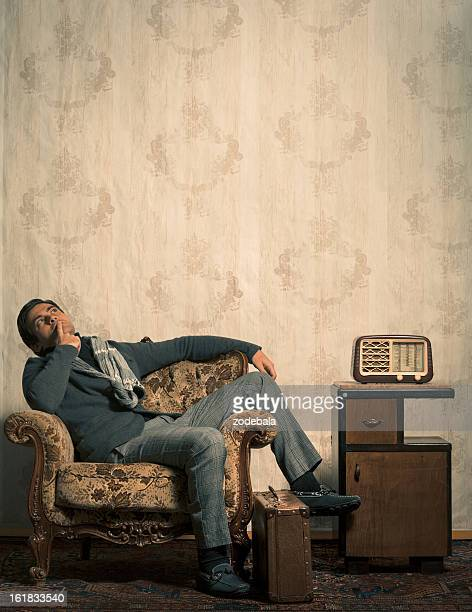 Elegant Retro Man Sitting in Vintage Room with Copy Space