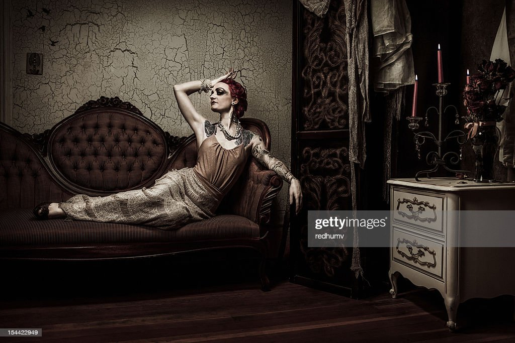 Elegant Retro Woman Lounging on Couch : Stock Photo