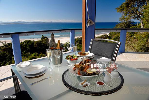 Elegant seafood dinner setting for two overlooking Byron Bay