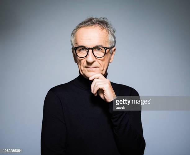 elegant senior man wearing black turtleneck - polo neck stock pictures, royalty-free photos & images