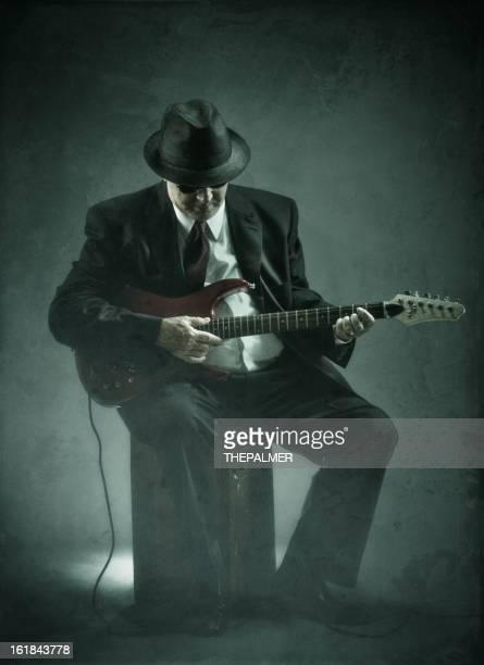 elegant senior playing an electric guitar