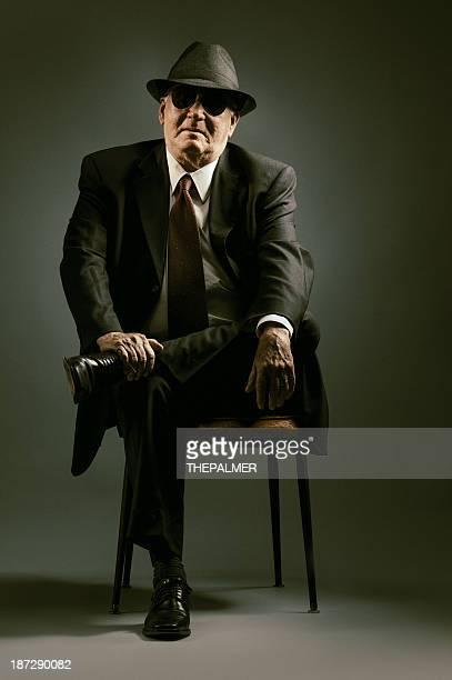 elegant senior seating - organized crime stock pictures, royalty-free photos & images