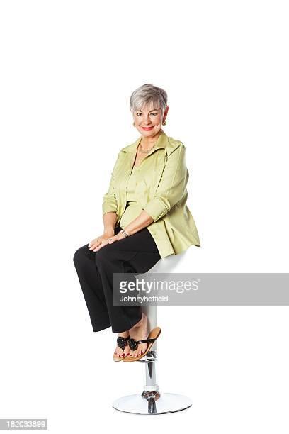 Elegant Senior Woman Relaxing On Chair