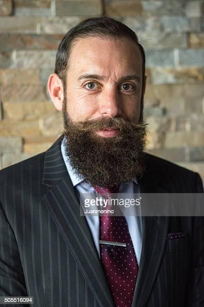 Elegant Smiling mature bearded man