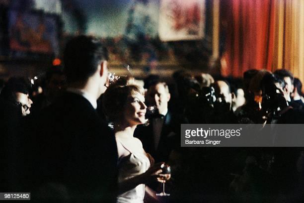 Elegant socialite woman arriving at ball