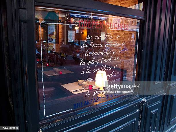Elegant streetwindow of a french bistro in Paris selling crepes