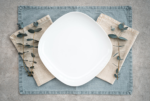 Elegant table setting decorated with eucalyptus branches 1146331485