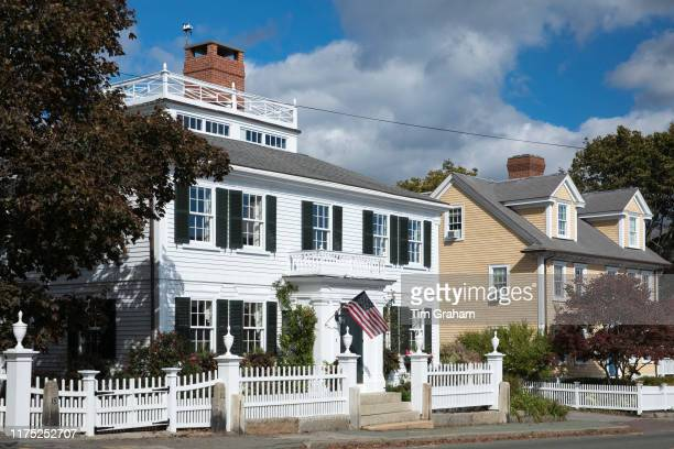Elegant traditional wooden clapboard house with patriotic Stars and Stripes flag at ManchesterbytheSea Massachusetts USA