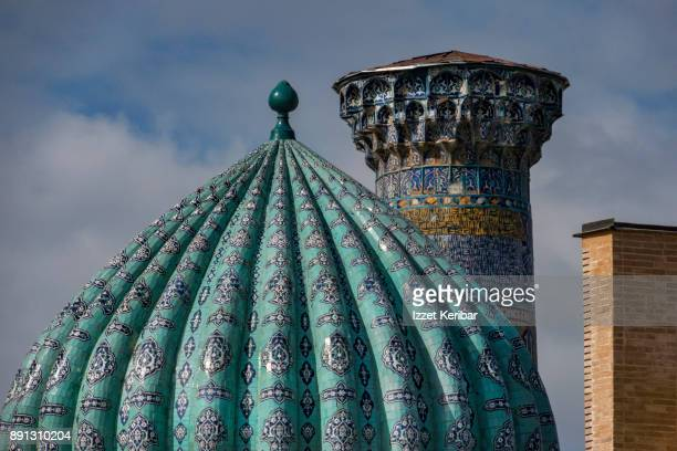 Elegant turquoise dome and minaret with blue tiles at Sheikh Zinda complex Samarkand, Uzbekistan