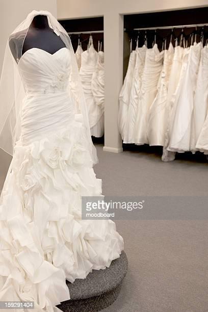 Elegant wedding dress displayed on mannequin in bridal store