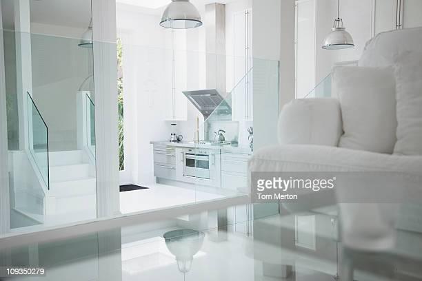 Elegant white living room and stainless steel kitchen