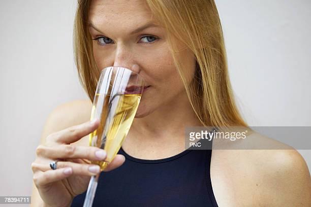 Elegant woman drinking champagne
