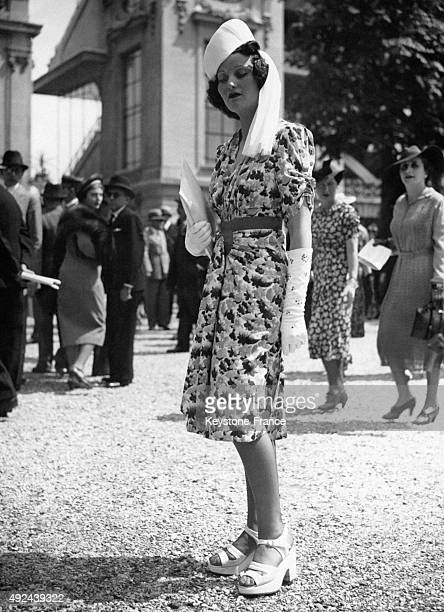 Elegant woman during the steeplechase of Auteuil on June 18 1939 in Paris France