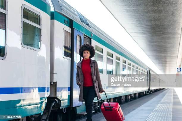 elegant woman going for business trip on train - trasporto ferroviario foto e immagini stock
