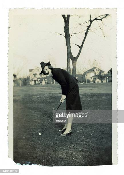 Elegant Woman in business costume golfing. Photograph. USA. 1940ies.